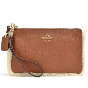 NWT Coach brown shearling wristlet!! PRICE FIRM